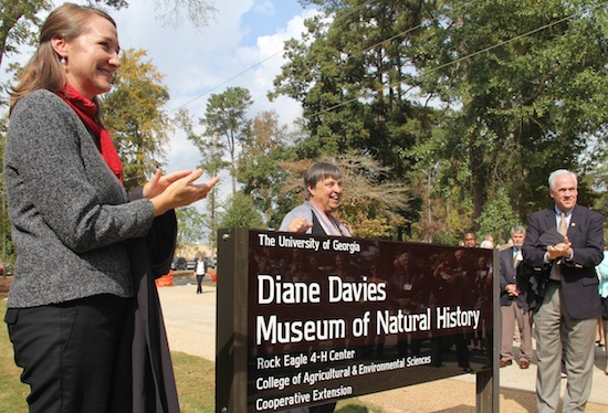 Georgia 4-H State Leader Arch Smith (right) and Georgia 4-H Environmental Education Program Director Melanie Biersmith unveil the sign at the Diane Davies Natural History Museum on Oct. 29, 2013. Davies, the founder of the program, looks on.