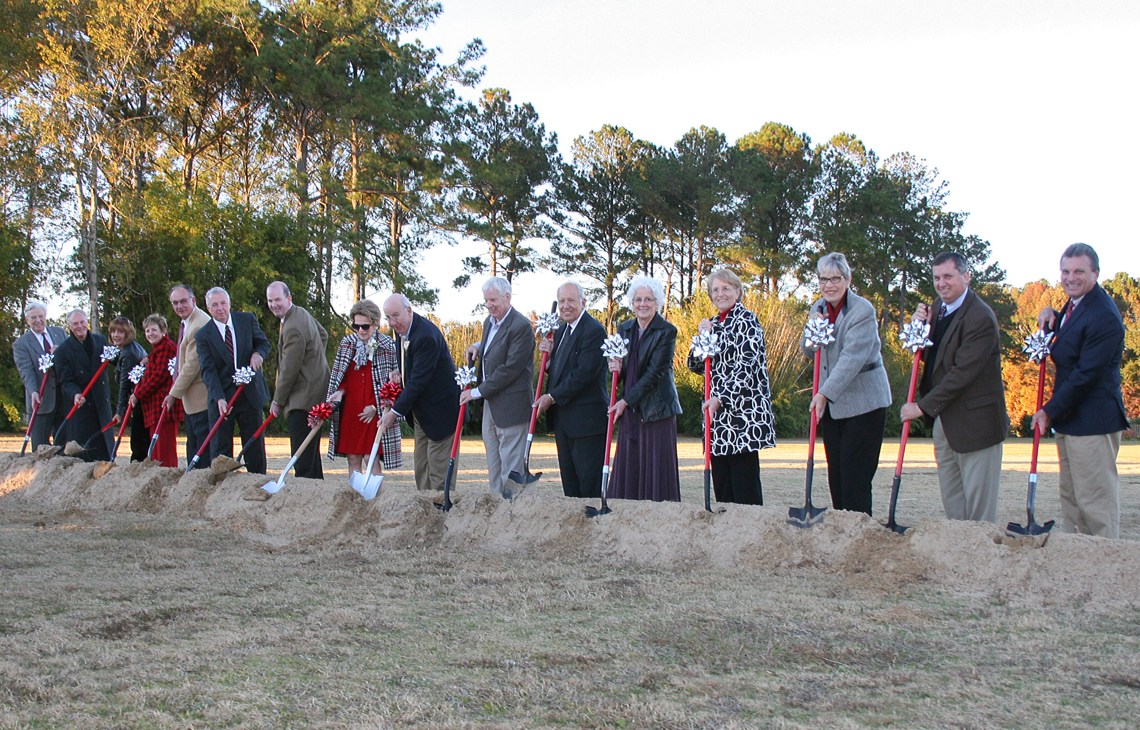 Jim and Barbara Andrews, center with red ribbons, helped to break ground on the Andrews Visitor and Education Center at the Coastal Georgia Botanical Gardens at the Historic Bamboo Farm in Savannah on Nov. 24, 2013.  The center, which was funded with a gift from the Andrews, will serve as center of learning and social activity as the garden undergoes major renovations over the next several years.