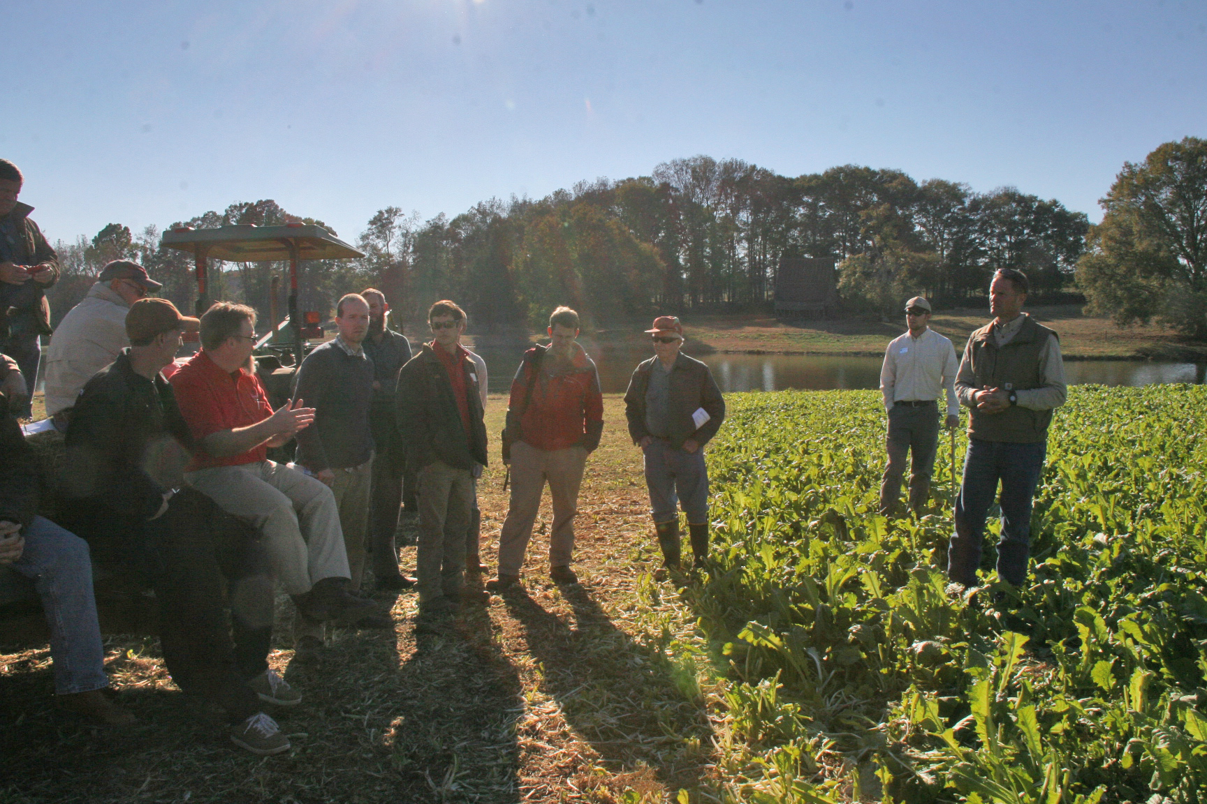 A group of northeast Georgia cattle farmers listens to a forage update from UGA Extension Specialist Dennis Hancock at Madison County farmer Terry Chandler's (far right) pasture.