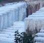 The fountain inside Galleria Gardens at the Atlanta Galleria Office Park sits frozen on the morning of Jan. 8, 2014.