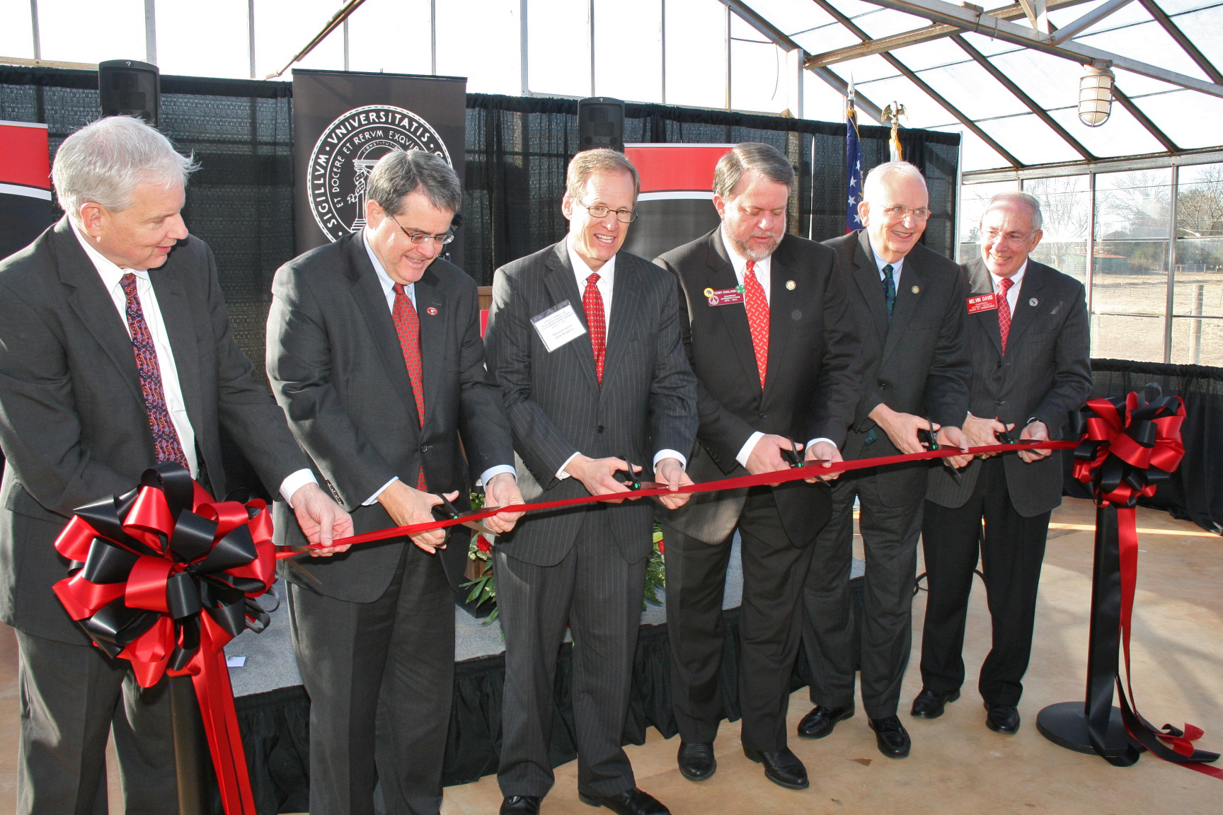 Dean J. Scott Angle, of the UGA College of Agricultural and Environmental Sciences; UGA President Jere Morehead, Rep. Jack Kingston, state Rep. Terry England, Georgia Commissioner of Agriculture Gary Black and Oconee County Commission Chairman Melvin Davis cut a ceremonial ribbon at UGA's J. Phil Campbell Sr. Research and Education Center Tuesday, Jan. 21.