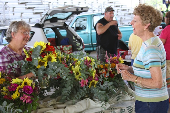 A grower sells fresh cut flowers at a farmers market in Henry County.
