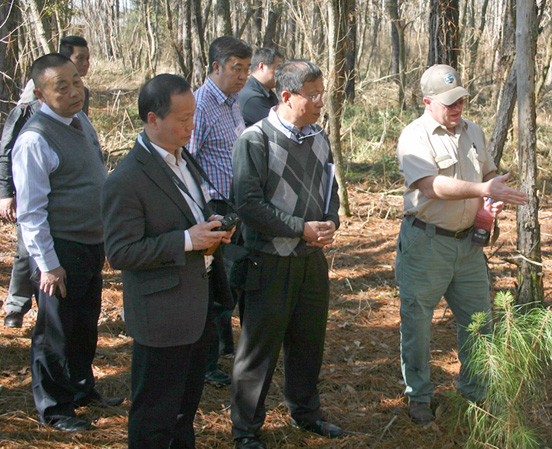 Mark McClure, Forest Health Specialist with the Georgia Forestry Commission, talks with members of a Chinese Delegation during a trip to south Georgia last month.