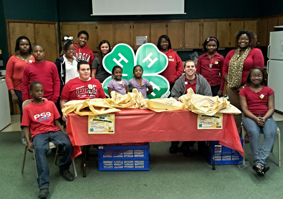 Joi Whitaker (standing, far right), a VISTA member serving in Thomas County, helped lead the MLK Day of Service School Supply Drive.