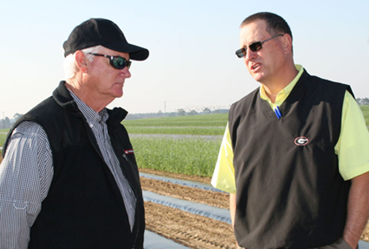 Philip Grimes credits a lot of his farming success to the work of UGA Extension, including Tift County Extension agent Brian Tankersley (right).