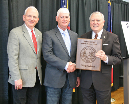 Georgia Farmer of the Year Philip Grimes receives a plaque from Gov. Nathan Deal, on right, and Agriculture Commissioner Gary Black, on left.