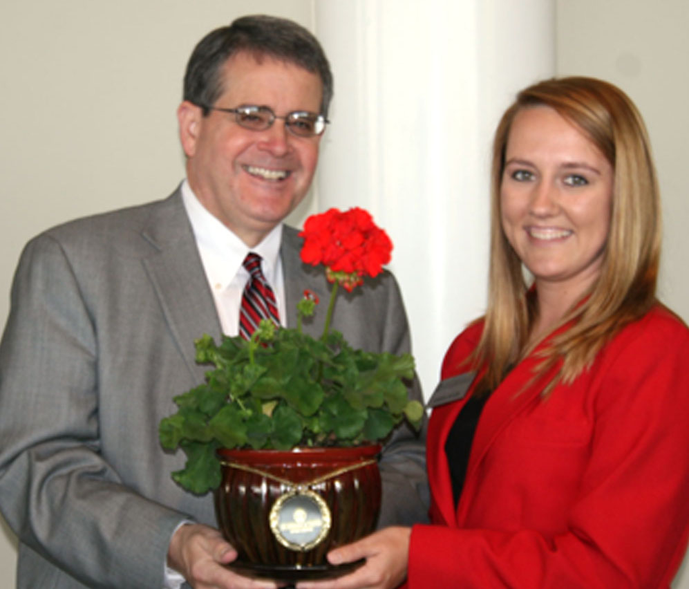 UGA President Jere Morehead receives a flower from a Tifton campus student ambassador during Morehead's visit on Wednesday.