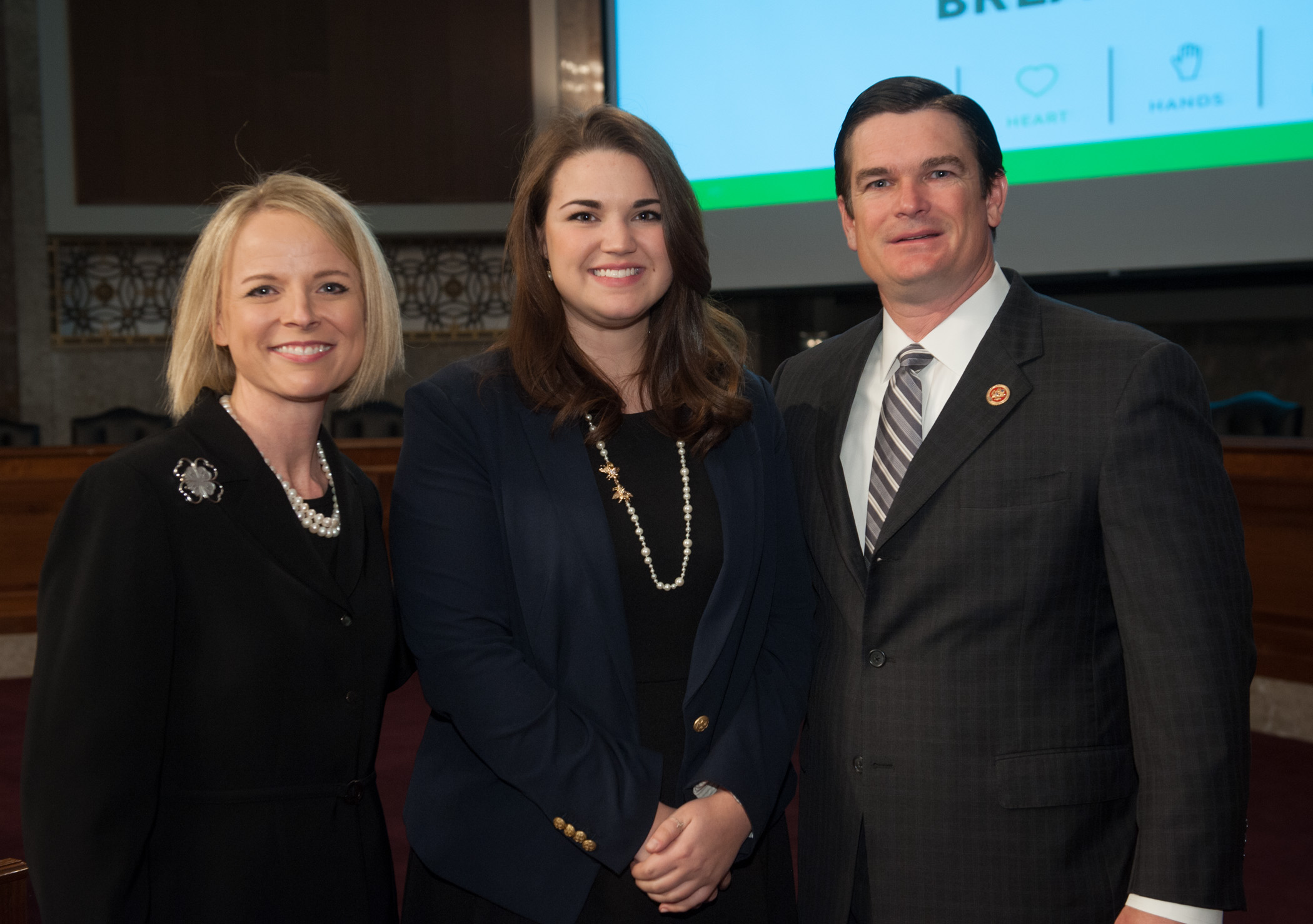 Jennifer Sirangelo, president and CEO, National 4-H Council, Tess Hammock, a National 4-H Council Youth Trustee, Georgia 4-h'er and agricultural communications student at UGA stand with Rep. Austin Scott, of Warner Robins, Ga., at the National 4-H Council's Congressional Breakfast on April 9.