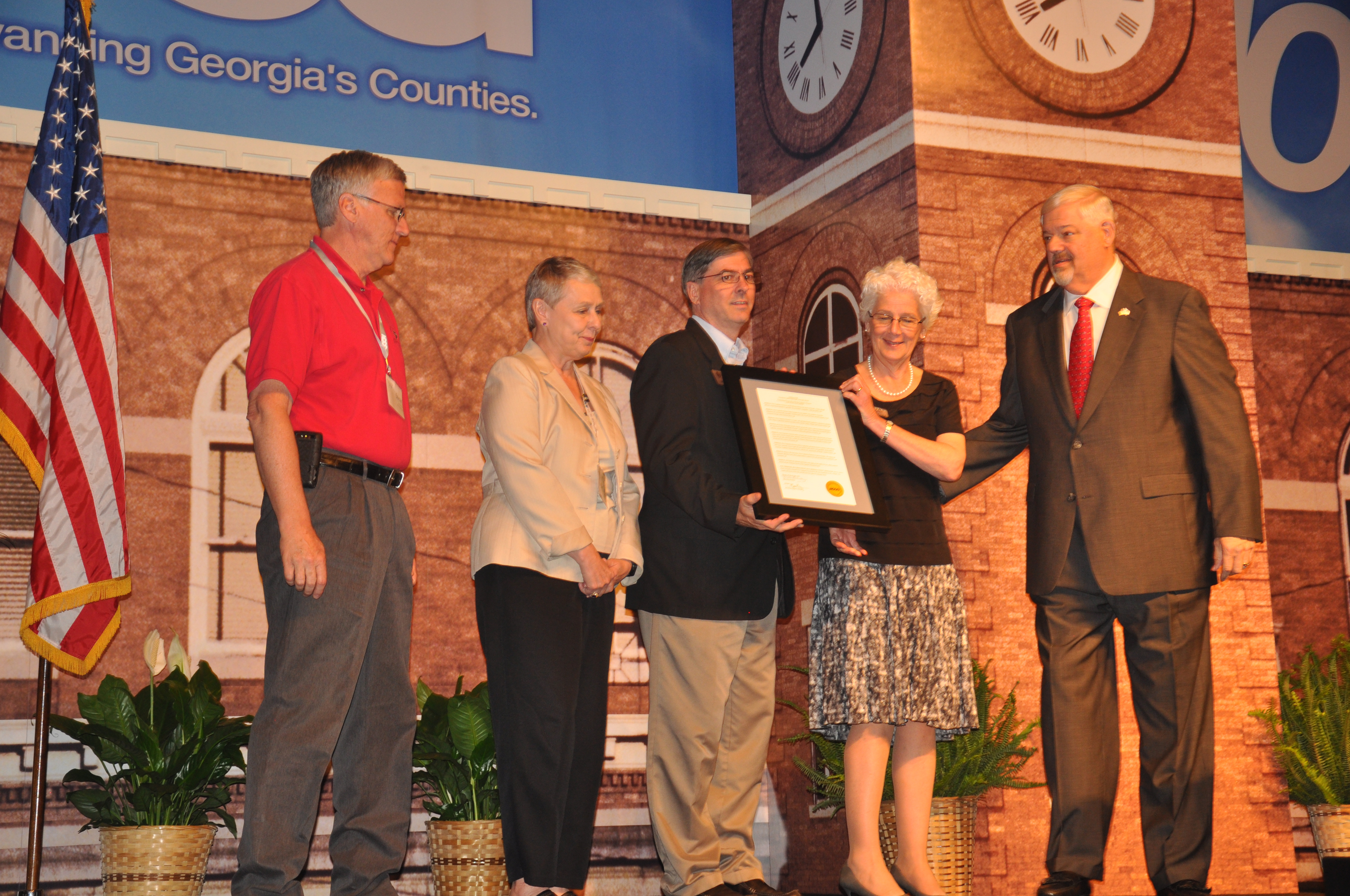 Associate Dean for Extension for the UGA College of Agricultural and Environmental Sciences Beverly Sparks accepts a proclamation recognizing the Georgia Association of Agricultural Agents from Mike Berg, outgoing president of the Association County Commissioners of Georgia.