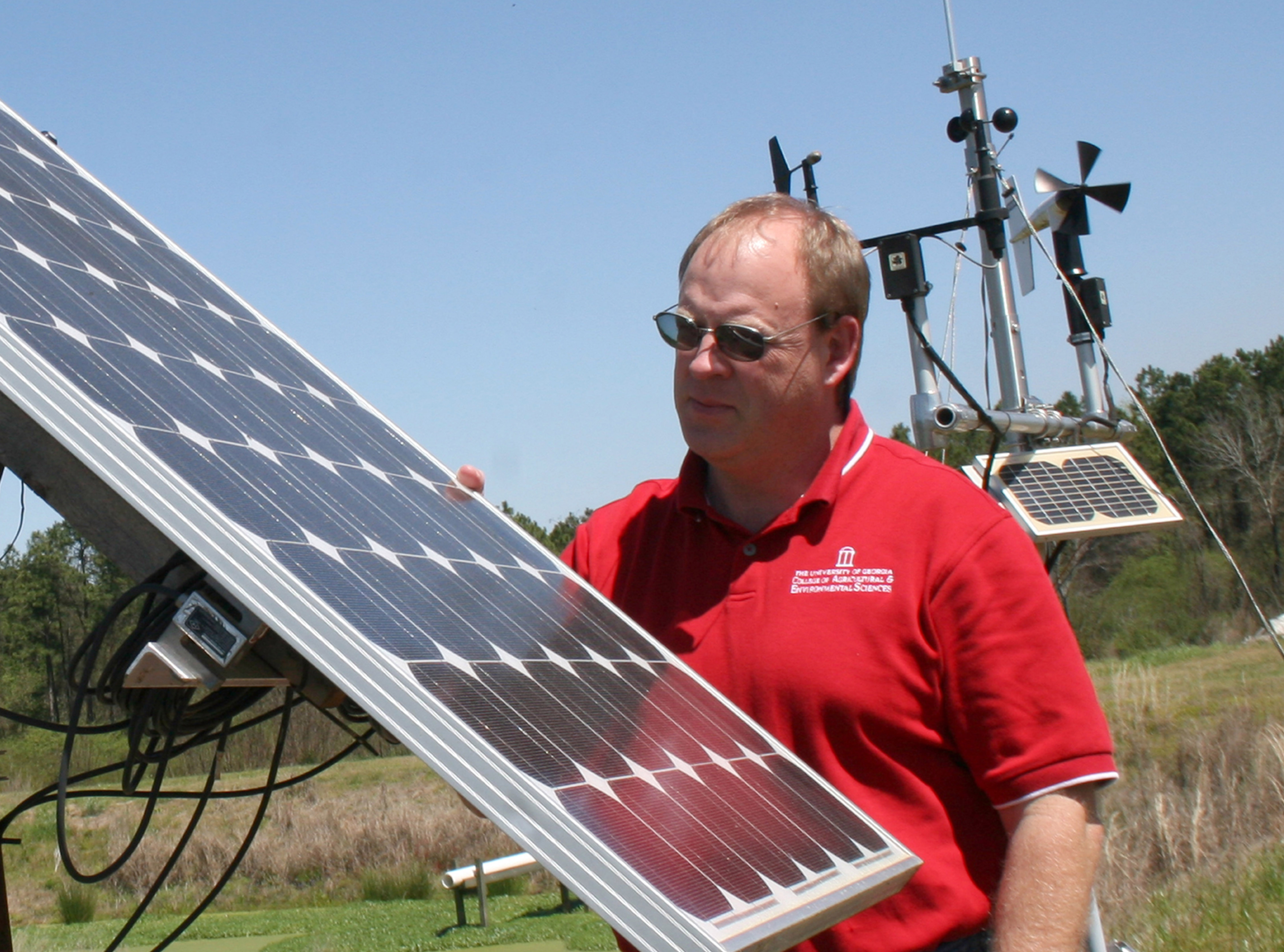 University of Georgia Extension water resource specialist Gary Hawkins looks over a solar panel.