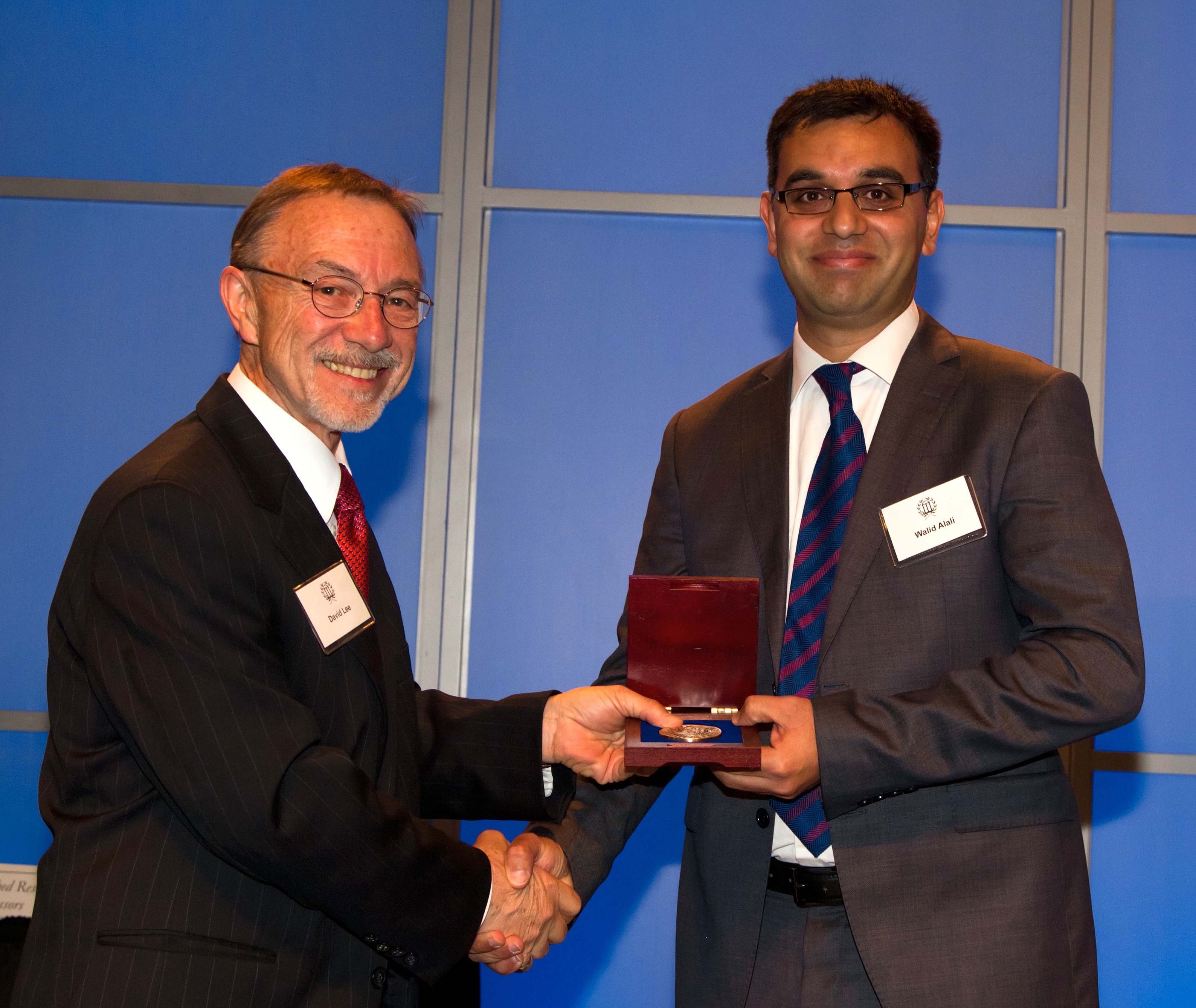 University of Georgia scientist Walid Alali was presented the university's 2014 Creative Research Medal based on his research on salmonella in the poultry industry. Alali is a food scientist with the University of Georgia College of Agricultural and Environmental Sciences. He is shown (right) receiving the honor from UGA Vice President for Research David Lee.