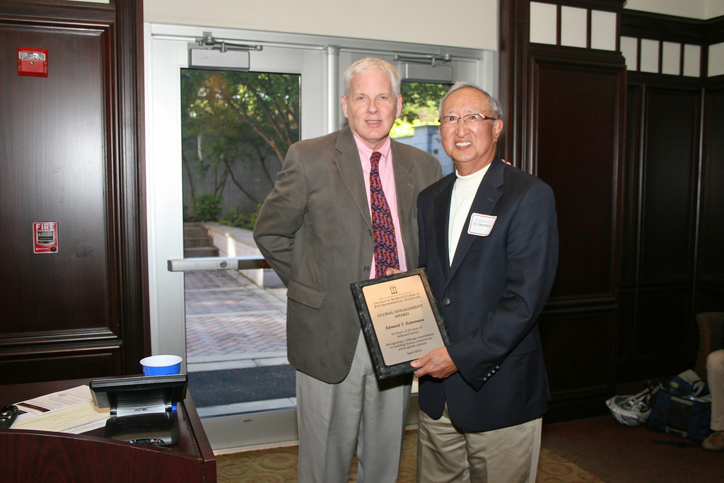 Retired director of the UGA CAES Office of Global Programs, Ed Kanemasu, receives a plaque in recognition of his years of service, from Dean J. Scott Angle, at the CAES international agriculture celebration.