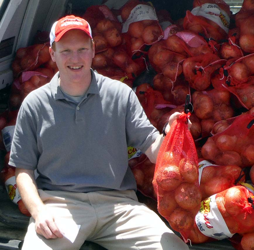 UGA Crop Quality Lab technician Daniel Jackson with a load of research samples from the Vidalia Onion Research Center. Jackson's lab will test between 2,500 and 5,000 of onions during May and June.
