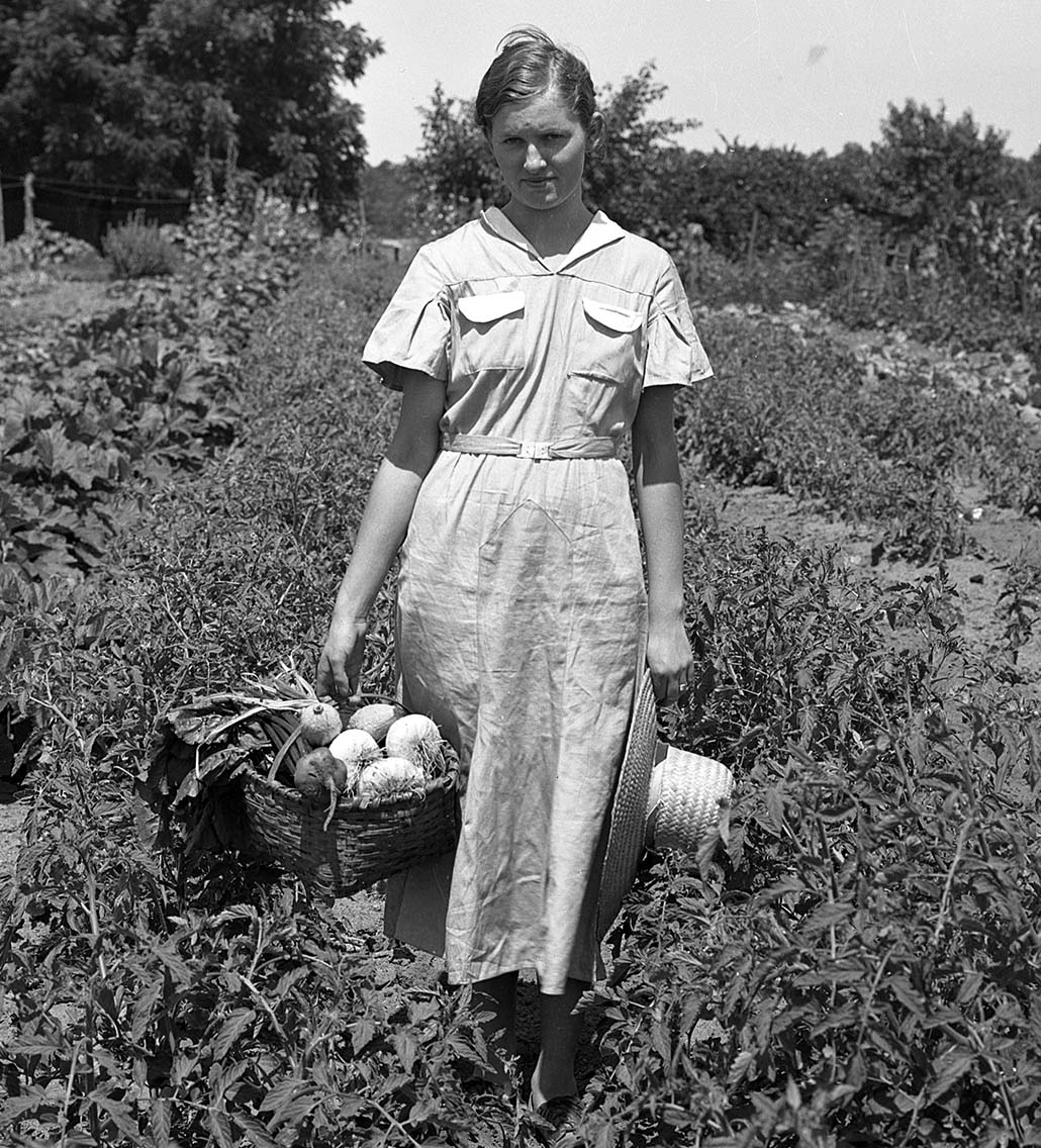 Doris Lester Dellinger, a Clarke County 4-H Club member, won second place in a statewide gardening contest in 1935. The garden was one acre in size, and in it she grew 18 different kinds of vegetables. The garden furnished all the vegetables needed for her 11 brothers and sisters and her parents. She married Edward Dellinger shortly after this photo was taken. This is one of thousands of photos included in the Digital Library of Georgia's UGA Extension archive.