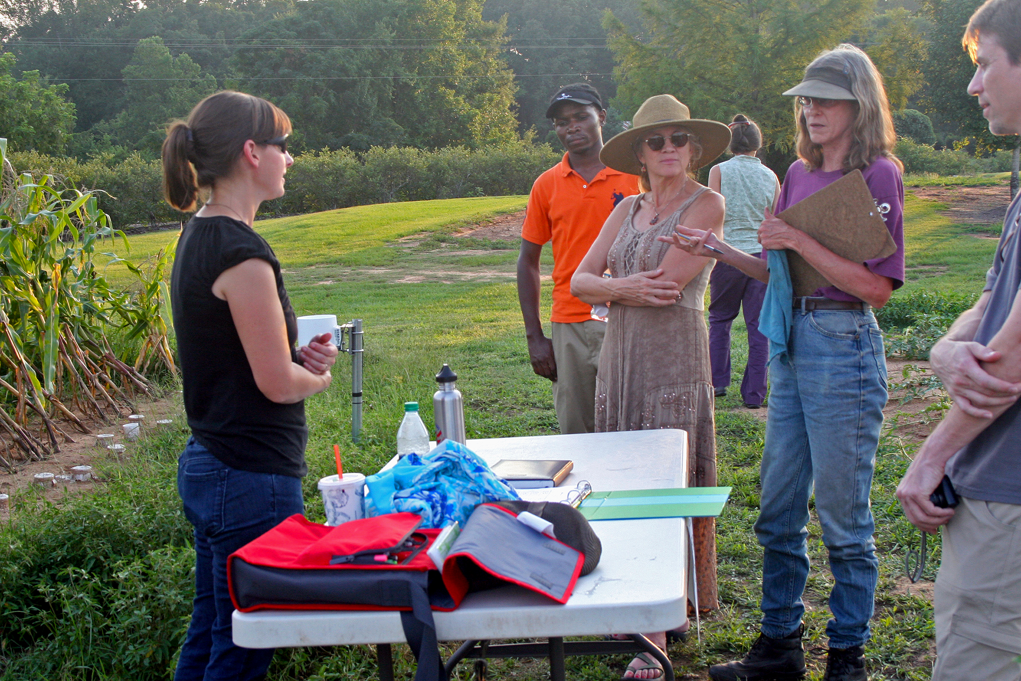 Attendees discuss growing practices at the University of Georgia's organic research farm in Watkinsville during the 2012 Organic Twilight Tour.