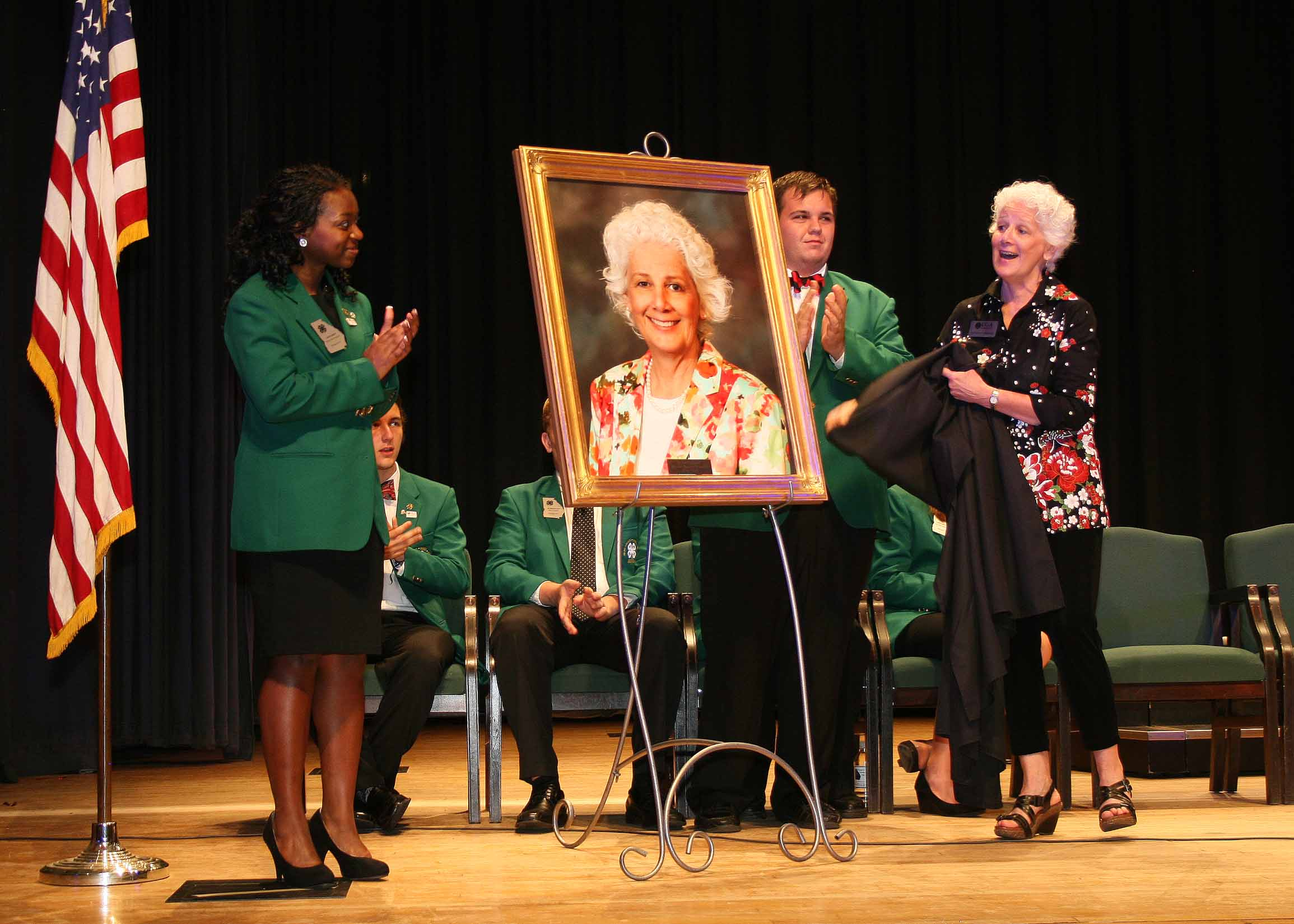 Georgia 4-H Club members honor Beverly Sparks, director of UGA Extension, at their 4-H Council meeting in June. Sparks, the first female leader of UGA Extension, will retire June 30. The 4-H club members presented Sparks with a portrait that will hang along side those of other past 4-H and UGA Extension leaders at Rock Eagle 4-H Center in Eatonton.