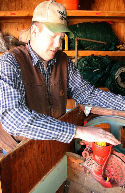 John Gassett shells corn for seed in the workshop of the UGA Variety Testing Program in Griffin, Ga.