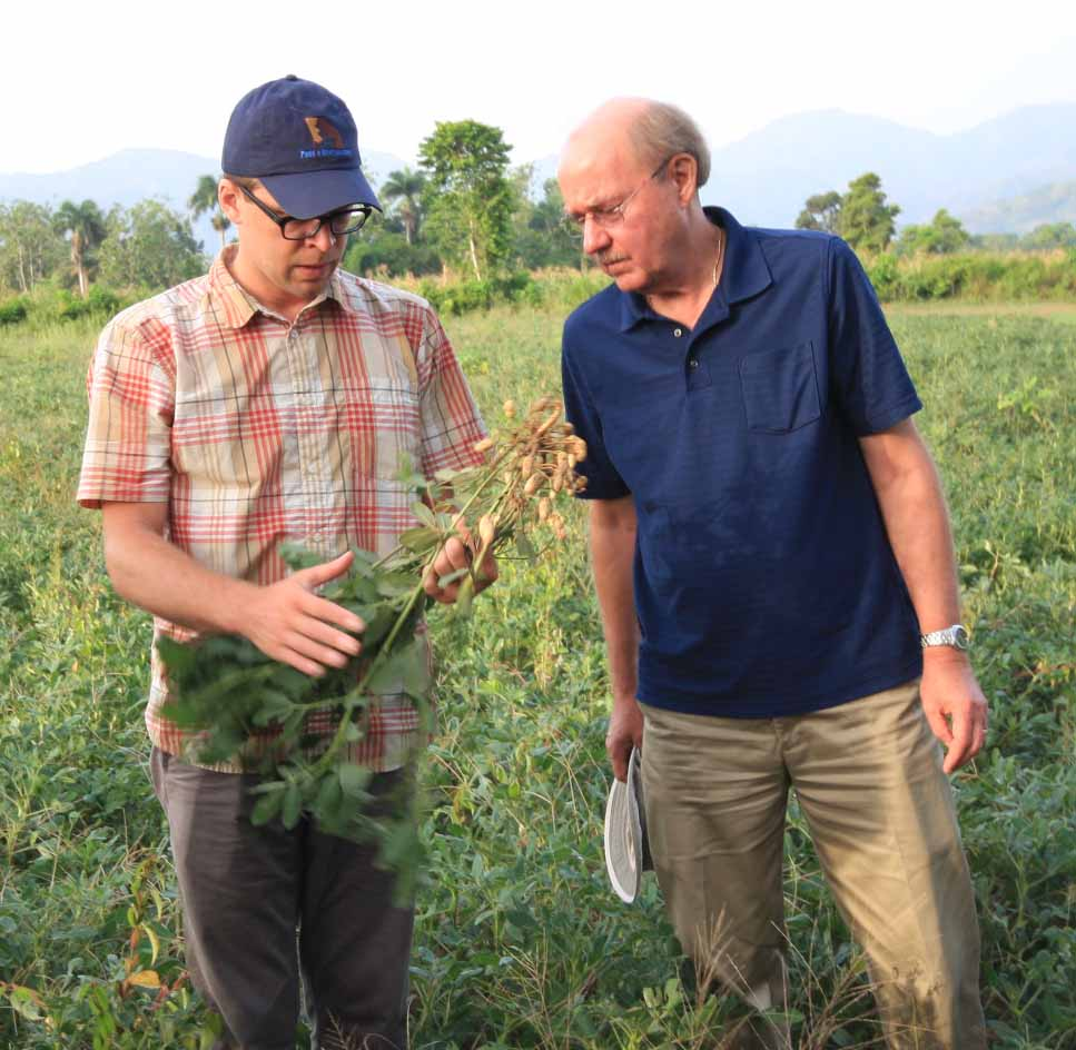 Dave Hoisington, right, director of the UGA-led Feed the Future Innovation Lab for Collaborative Research on Peanut and Mycotoxin, and Jamie Rhoads, incoming assistant director, check out peanuts in a field in Tierra Muscady, Haiti.