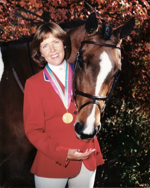 """World Cup rider Melanie Smith Taylor is one of only two riders to ever win the """"Triple Crown of Show Jumping."""" She is the only rider to win the American Invitational, the International Jumping Derby and the American Gold Cup on the same horse, Calypso who is shown with her in the photo."""