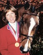 "World Cup rider Melanie Smith Taylor is one of only two riders to ever win the ""Triple Crown of Show Jumping."" She is the only rider to win the American Invitational, the International Jumping Derby and the American Gold Cup on the same horse, Calypso who is shown with her in the photo."