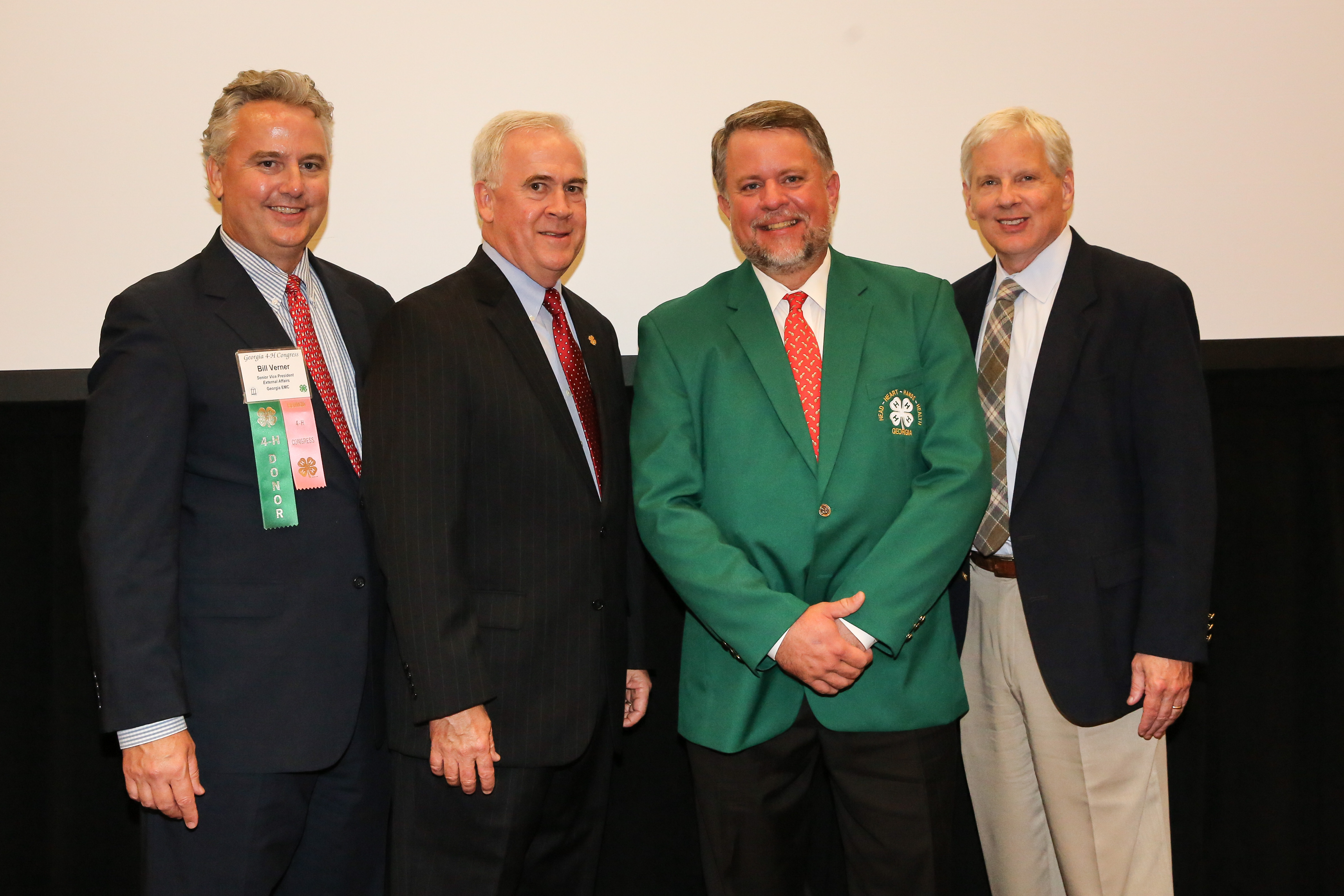 Georgia Representative Terry England is the 2014 winner of the Georgia 4-H Green Jacket Award. Sponsored by Georgia EMC, the green jacket award is presented annually to an individual who has exhibited outstanding support of the Georgia 4-H program. Pictured left to right are Georgia EMC Senior Vice-President of External Affairs Bill Verner, Georgia 4-H State Leader Arch Smith, Representative Terry England and University of Georgia College of Agricultural and Environmental Sciences Dean and Director Scott Angle.