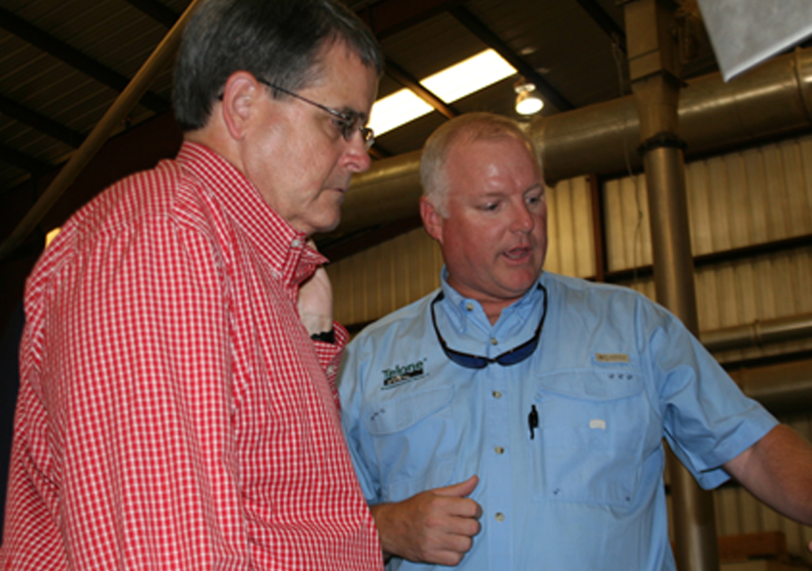 UGA President Jere Morehead meets with Ben Evans, manager of Coffee County Cotton Gin in Douglas on Wednesday, Sept. 3, 2014.
