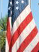 4-H'ers at Camp Burton on Tybee Island raise the American flag during the 2009 Operation Purple Camp.