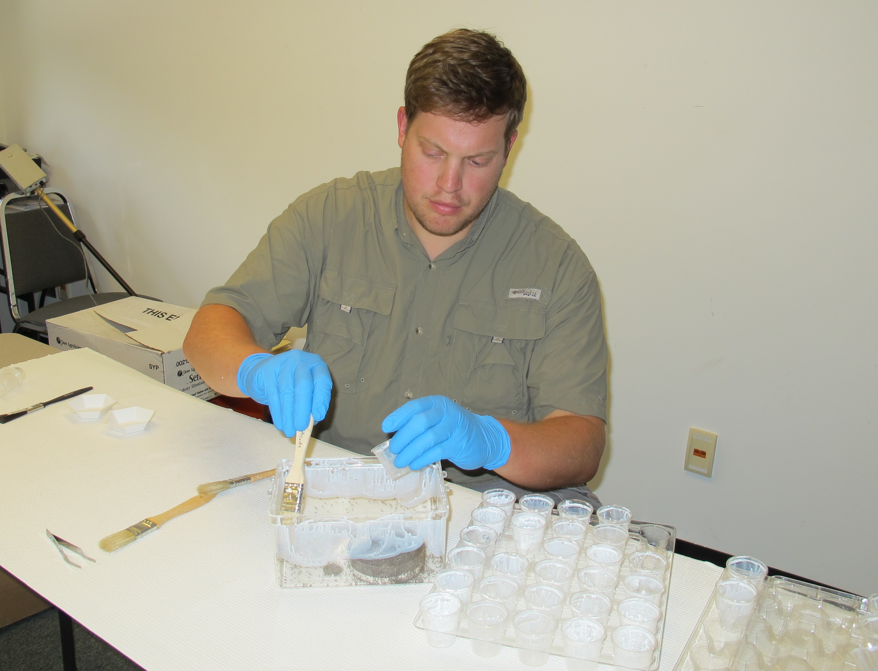 University of Georgia alumnus Jacob Holloway is shown preparing to test natural products as pest repellants in a laboratory on the campus in Griffin. He tested a few natural remedies as part of his Master's thesis for the College of Agricultural and Environmental Sciences.