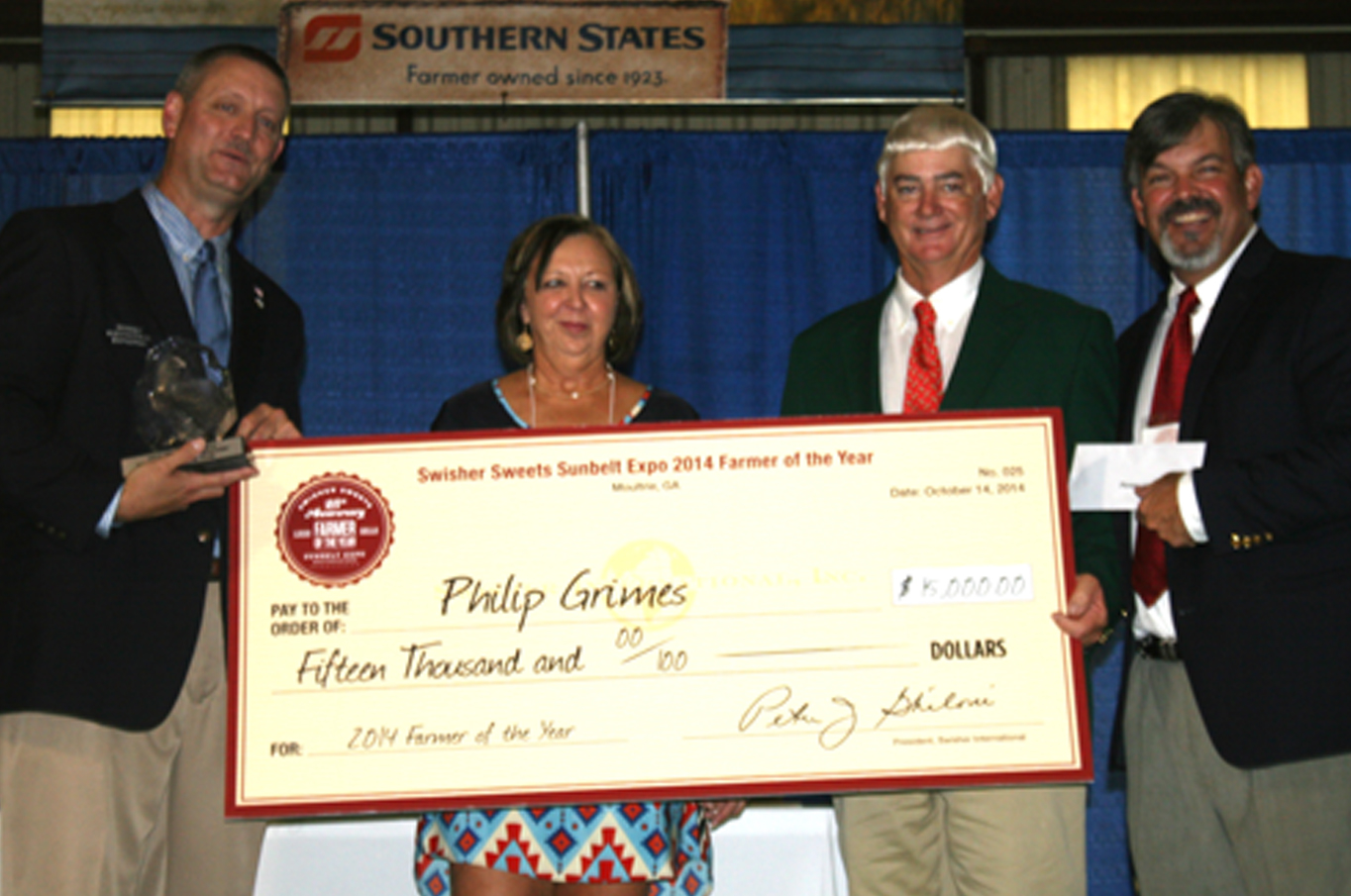 Pictured are, from left, Chip Blaylock, executive director of the Sunbelt Expo, Philip Grimes' wife Jane, Philip Grimes and Swisher Sweets representative Ron Carroll.