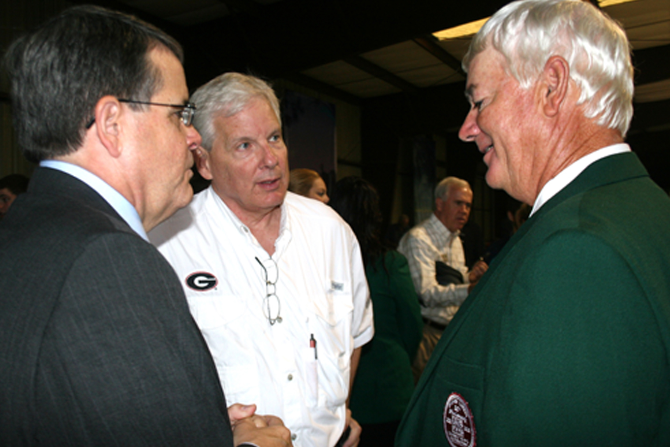 University of Georgia President Jere Morehead talks with Scott Angle (left), dean of the UGA College of Agricultural and Environmental Sciences and Tifton farmer Philip Grimes, who was named the Southeastern Farmer of the Year at the Sunbelt Expo on Tuesday, Oct. 14, 2014.