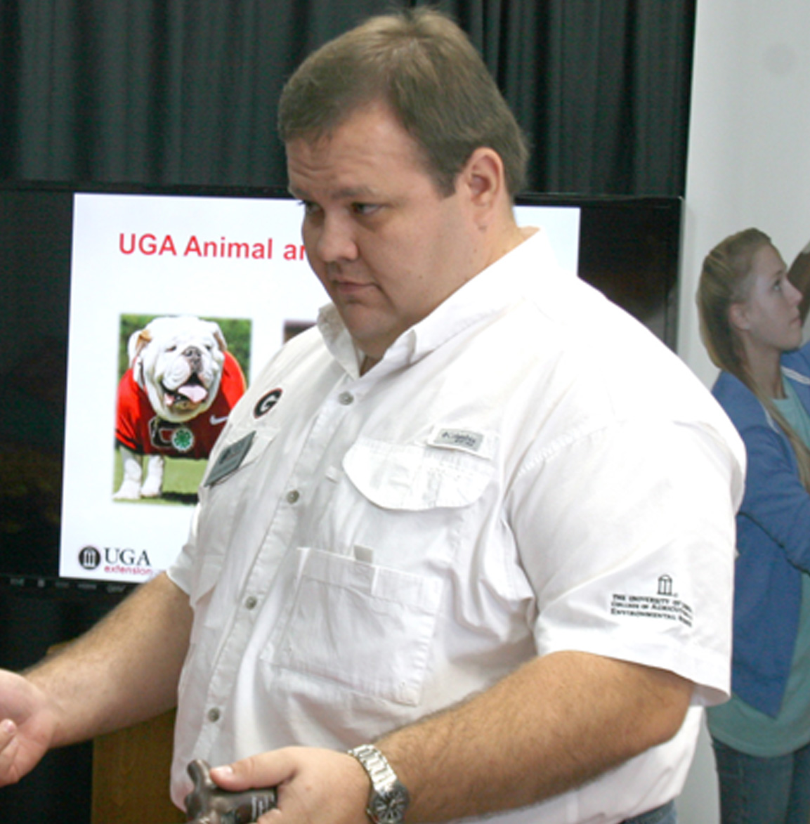 Jacob Segers, beef cattle specialist at the UGA Tifton Campus, works at the Sunbelt Expo in Moultrie on Wednesday, Oct. 15.