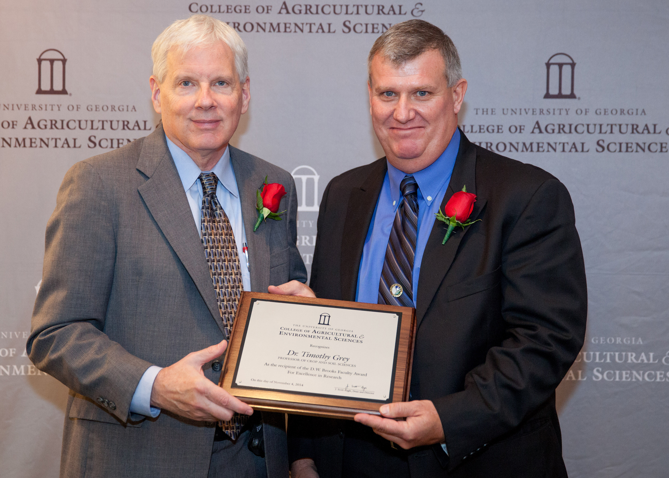 Dean J. Scott Angle presents Professor Timothy Grey, of the Department of Crop and Soil Sciences, with the D.W. Brooks Faculty Award for Excellence in Research. The award recognizes his work combatting herbicide-resistant Palmer amaranth, or pigweed, and developing weed management strategies to replace a recently banned soil fumigant—methyl bromide.