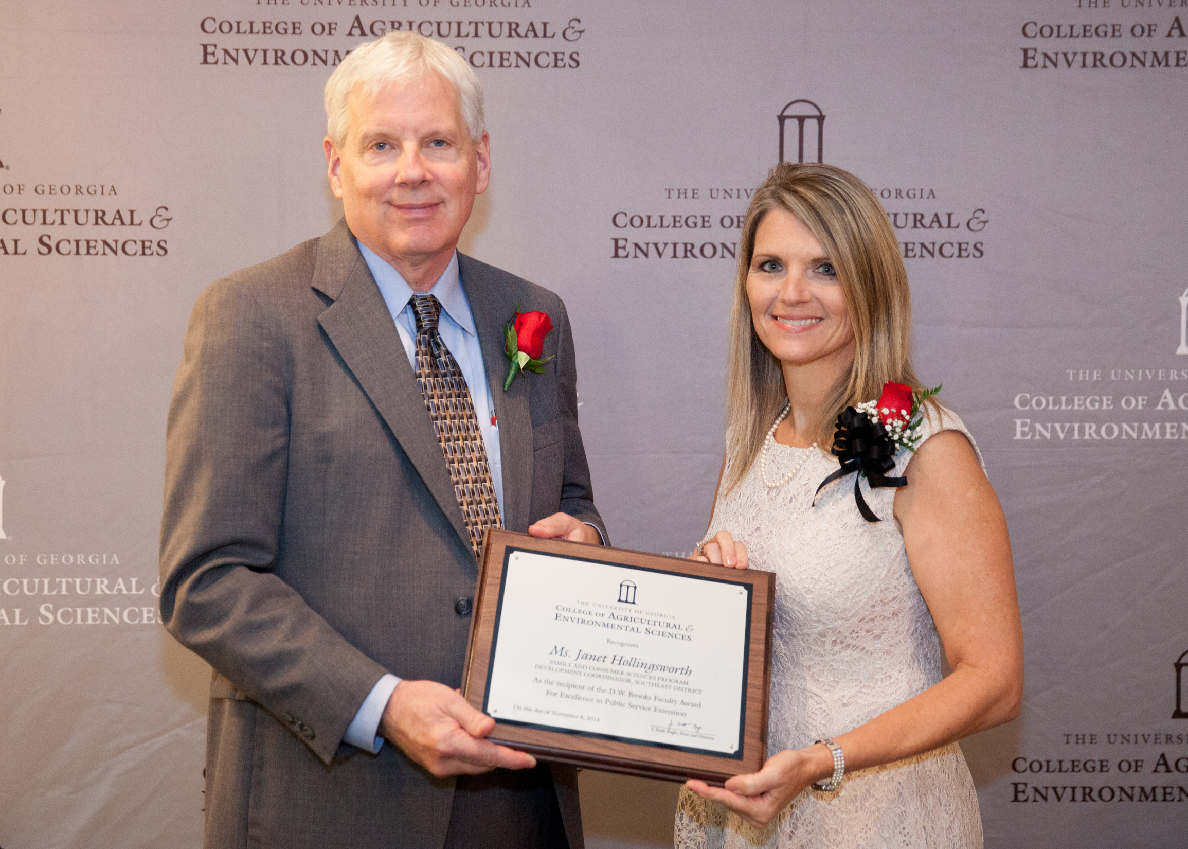 Dean J. Scott Angle presents Janet Hollingsworth, Family and Consumer Sciences program development coordinator for southeastern Georgia, with the D.W. Brooks Faculty Award for Excellence in Public Service Extension. The award recognizes her work developing successful public health, nutrition and safety programing in Appling and Wayne counties.