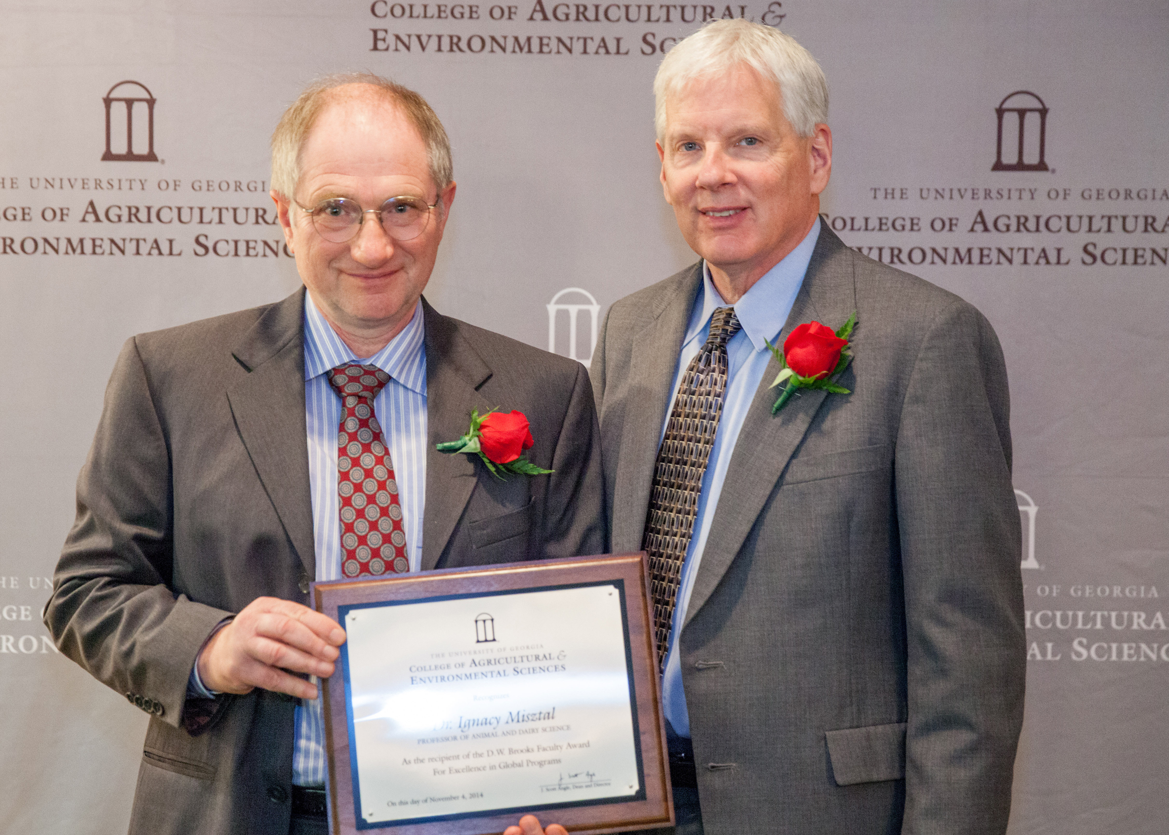 Dean J. Scott Angle presents Professor Ignacy Misztal, of the Department of Animal and Dairy Science, with the D.W. Brooks Faculty Award for Excellence in Global Programs. The award recognizes his worldwide reputation as an expert on genetic analysis and animal breeding, and the number of international scholars who have come to UGA to study with him.