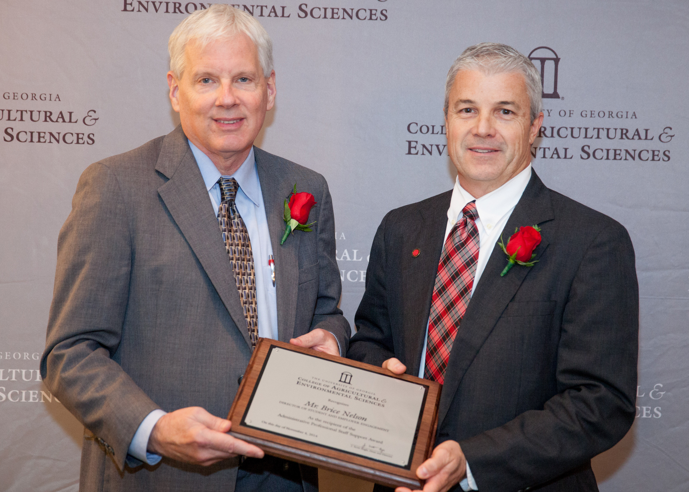 Dean J. Scott Angle presents Brice Nelson, director of student and employer engagement, with the CAES Staff Award for Administrative or Professional Support. Nelson has led the college's student recruitment efforts for the past decade and has helped to nearly double the college's enrollment.