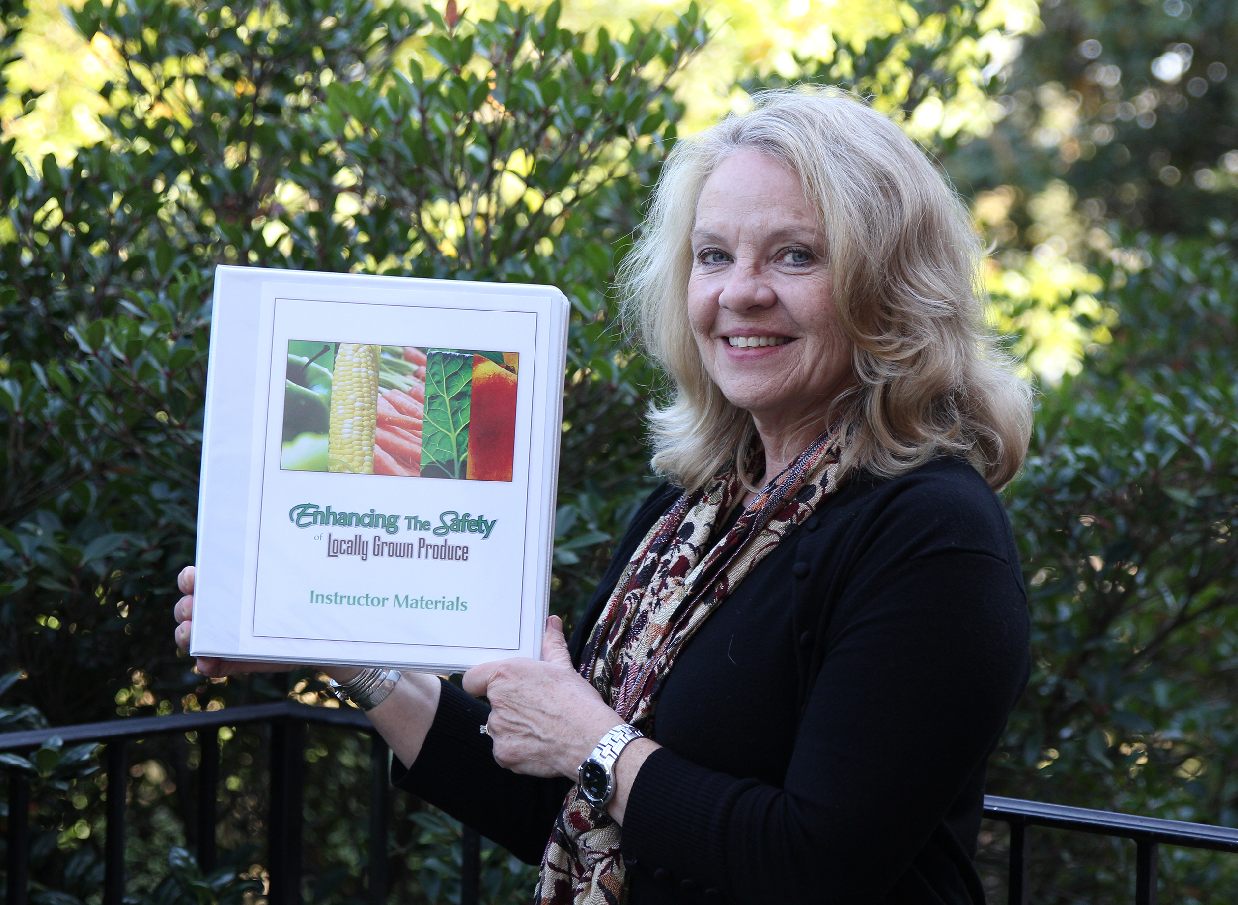"""Judy Harrison, UGA Extension food safety specialist, with the project she helped create: """"Enhancing the Safety of Locally Grown Produce."""""""