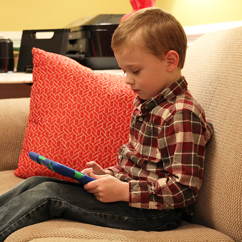 5-year-old Parks Powell plays an educational game on his parents' iPad.