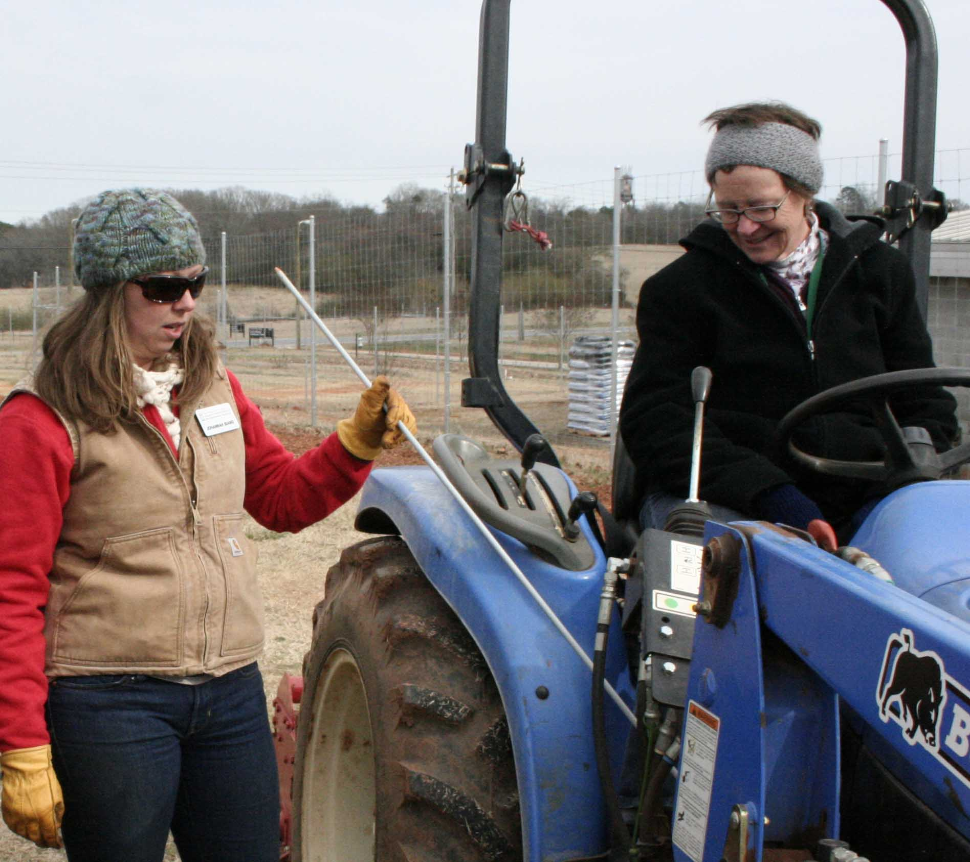 UGArden manager JoHannah Biang teaches Andy Myers, Lipscomb University student of sustainability and environmental agriculture, how to drive a small tractor as part of a workshop at the 2015 Georgia Organics Conference, Feb. 20-21, in Athens.