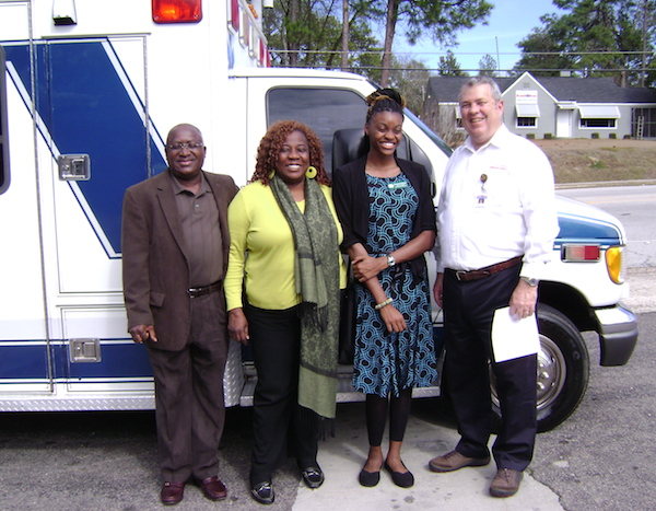 Hancock County 4-H'er Shameka Robinson's search for an ambulance ended rather quickly when Jim Adkins, CEO of SouthStar EMS in Augusta, donated a fully equipped ambulance. The donation goes to the Nhyira Medical Relief organization, a 501(c)(3) nonprofit group operated by Dr. Sam Amporful and his wife, Sabina, of Macon, Georgia. Pictured left to right are Dr. Amporful, Mrs. Amporful, Robinson and Adkins.