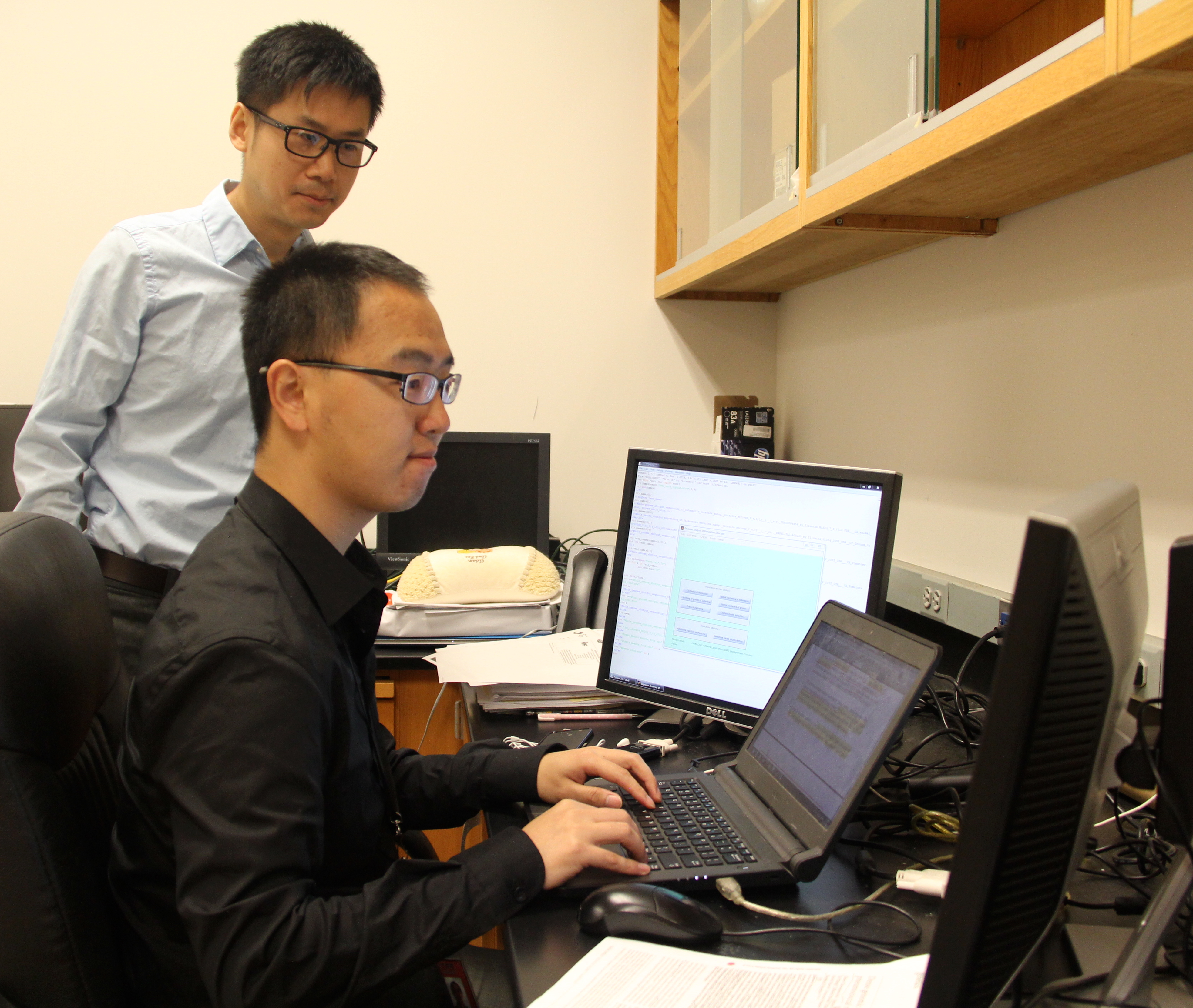 "University of Georgia scientist ""Sean-u"" Deng (standing) and College of Agricultural and Environmental Sciences food science graduate student Shaokang Zhang have developed SeqSero, a bioinformatics tool that identifies serotypes, or individual, distinct strains, of salmonella using whole genome sequencing (WGS). The website is used by public health officials and scientists across the globe."