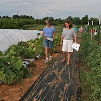 Two women tour the organic production plots at UGA's Durham Horticulture Farm during UGA's 2014 Organic Twilight Tour.