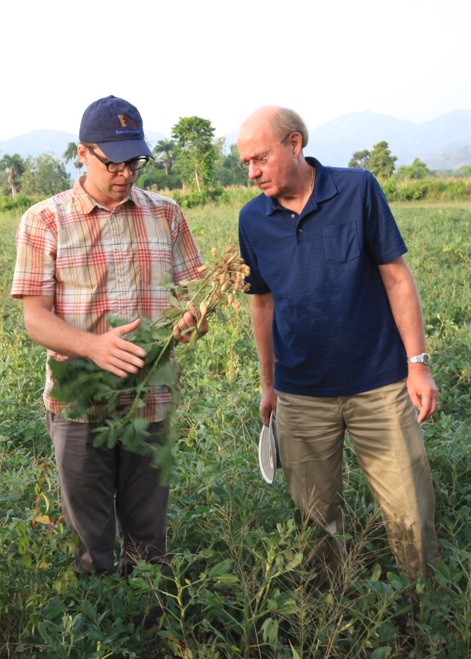 PMIL Assistant Director Jamie Rhoads and Director Dave Hoisington inspect peanuts during a 2014 trip to Haiti.