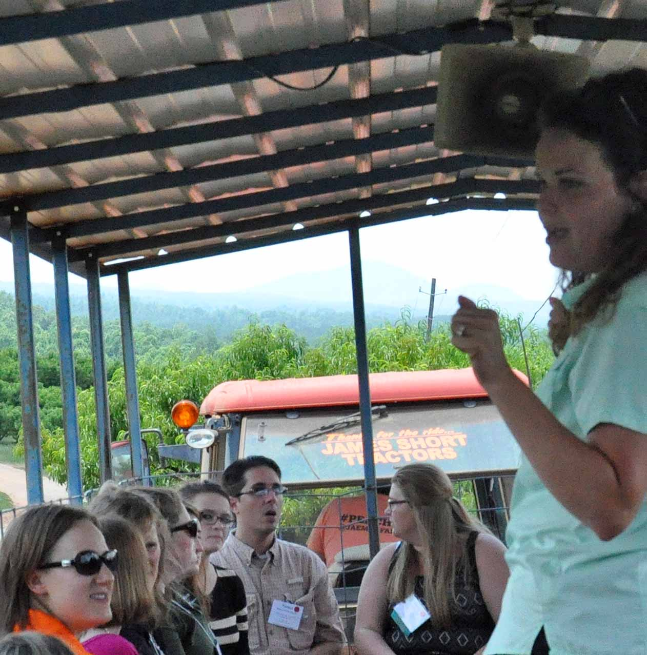 Caroline Lewallen, education coordinator for Jaemor Farms in Alto, tells NACTA convention-goers about the 750,000 customers served by the north Georgia fruit and vegetable farm.