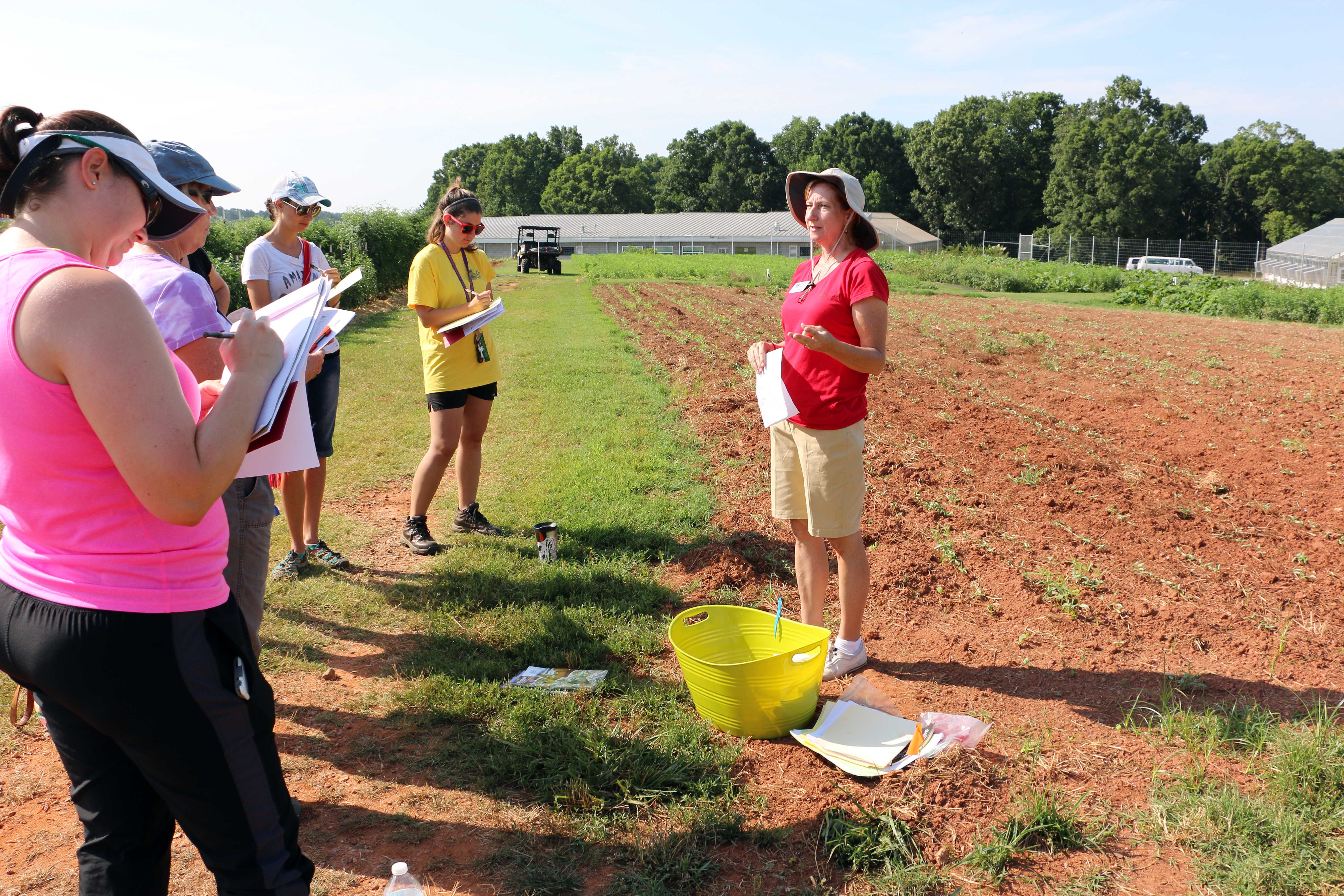 Becky Griffin, UGA Extension community and school garden coordinator, speaks to a group of teachers at a school garden curriculum training at UGArden in Athens, Georgia.