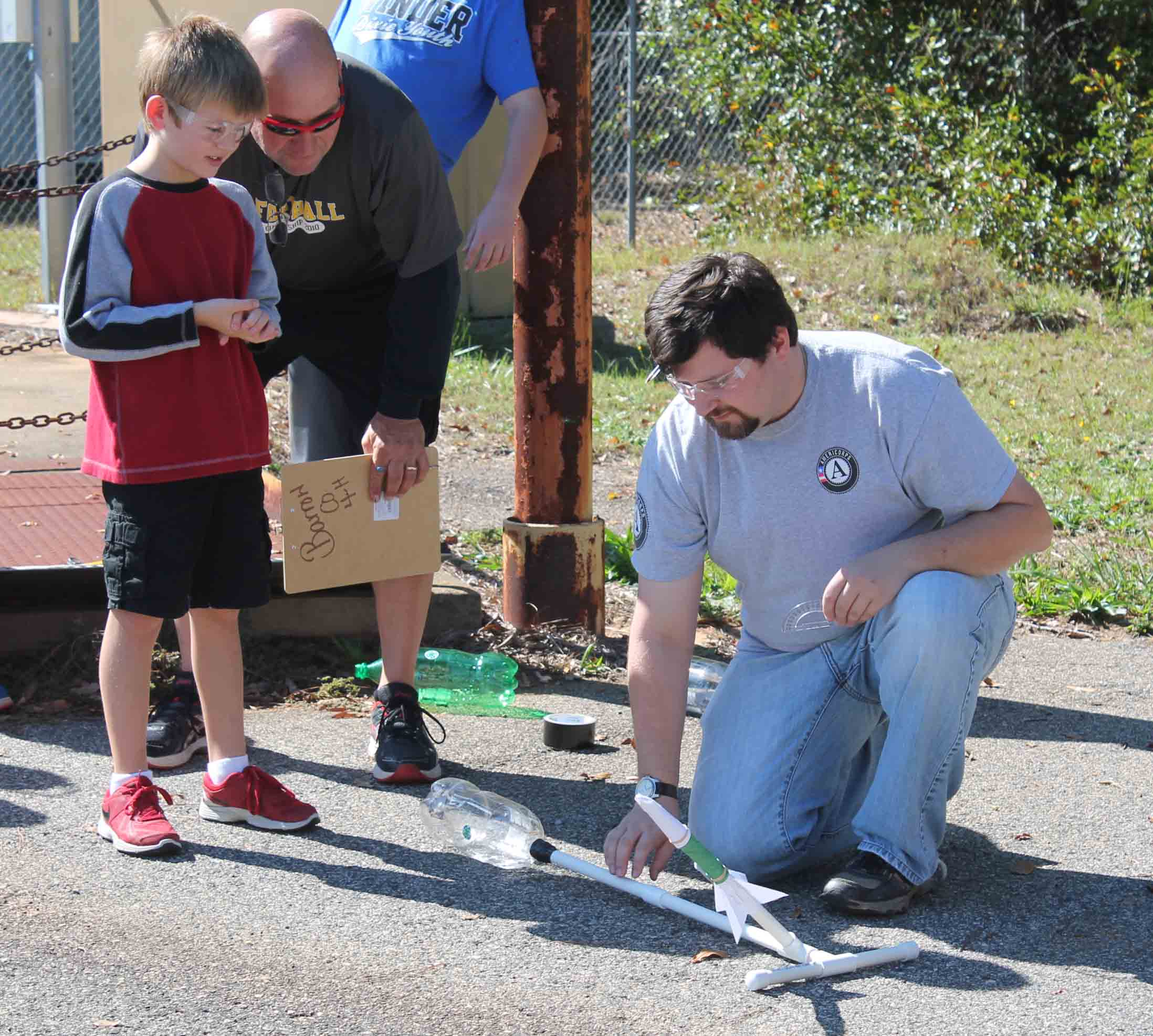 Jonathan Page, an AmeriCorps service member working with Georgia 4-H, helps  Barrow County 4-H'ers with a National Youth Science Day project.