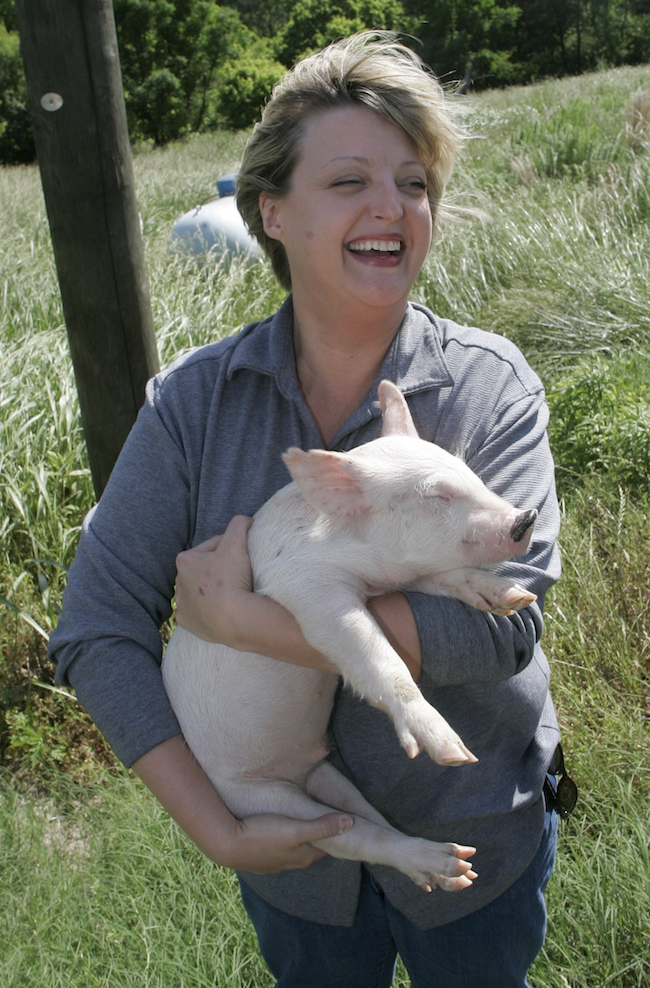 Woman holding pig