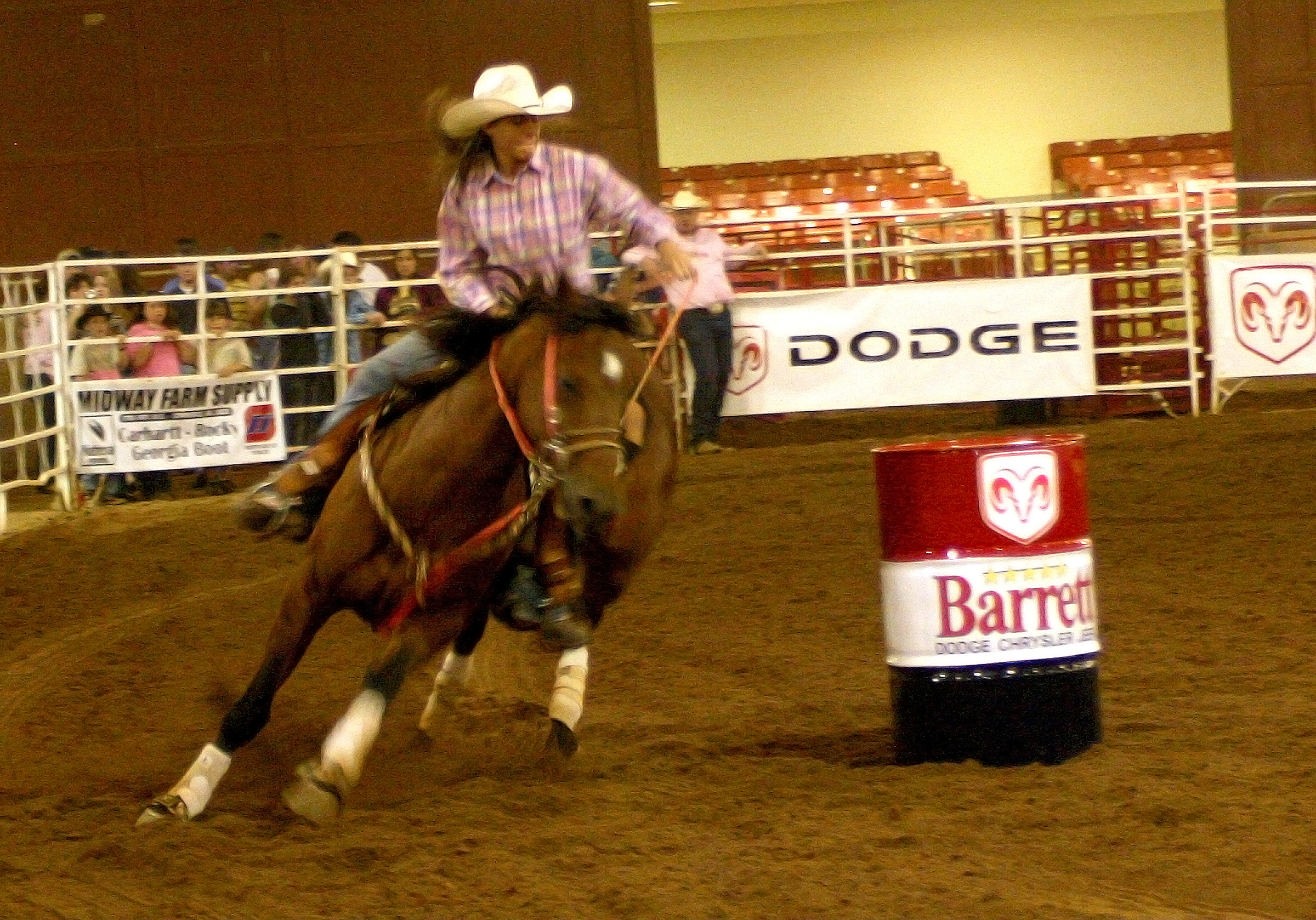 A barrel racing competitor leans her horse into the turn during the Great Southland Stampede Rodeo.