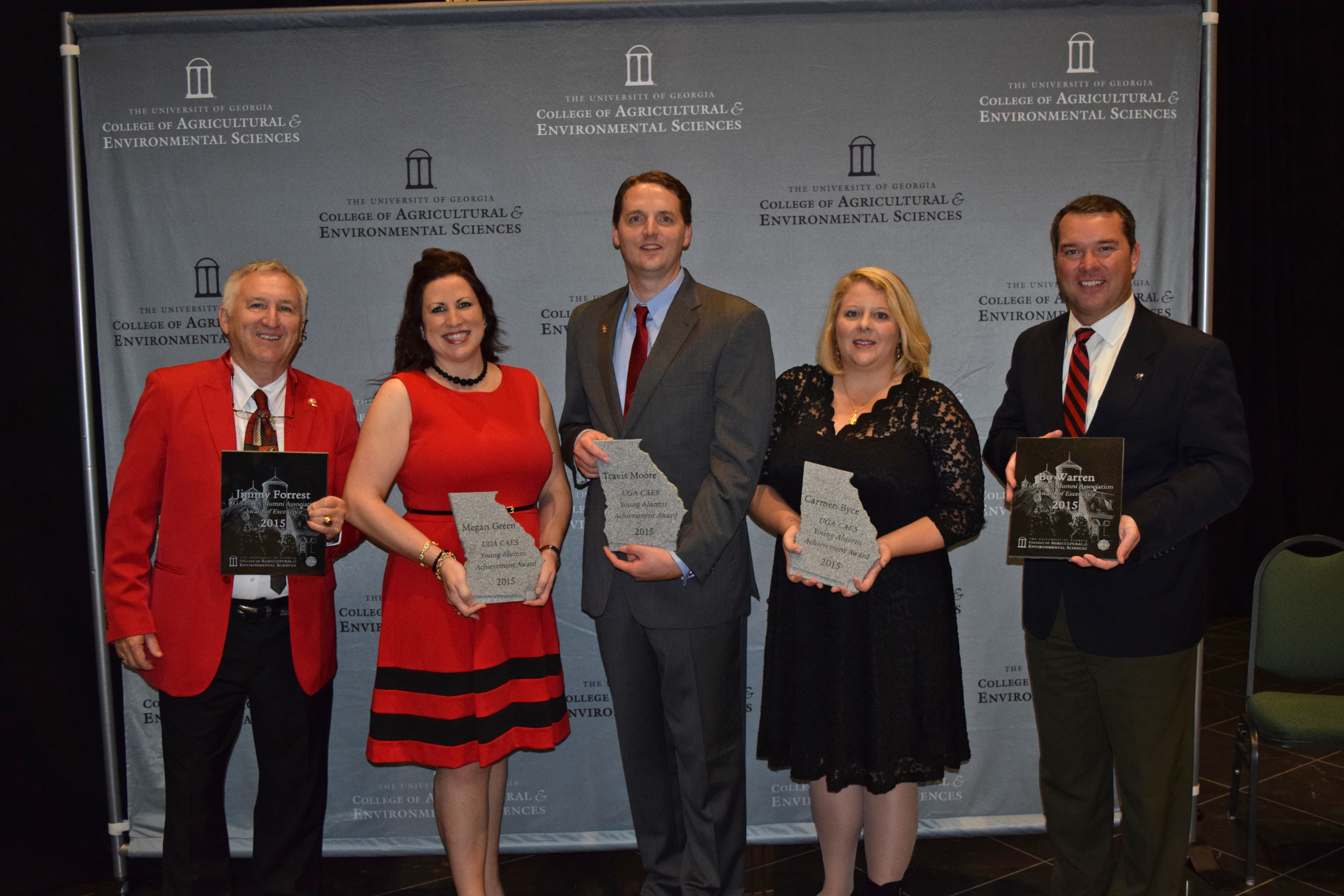 CAES Alumni Association Award of Excellence winners Jimmy Forrest, left, and Bo Warren flank the 2015 CAES Alumni Association Young Alumni Award winners Megan Greene, Travis Moore and Carmen Byce.