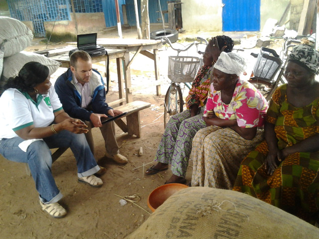 UGA agricultural economist Nick Magnan and his colleague Grace Motey interview women who work buying and selling peanuts at a market in Ghana.