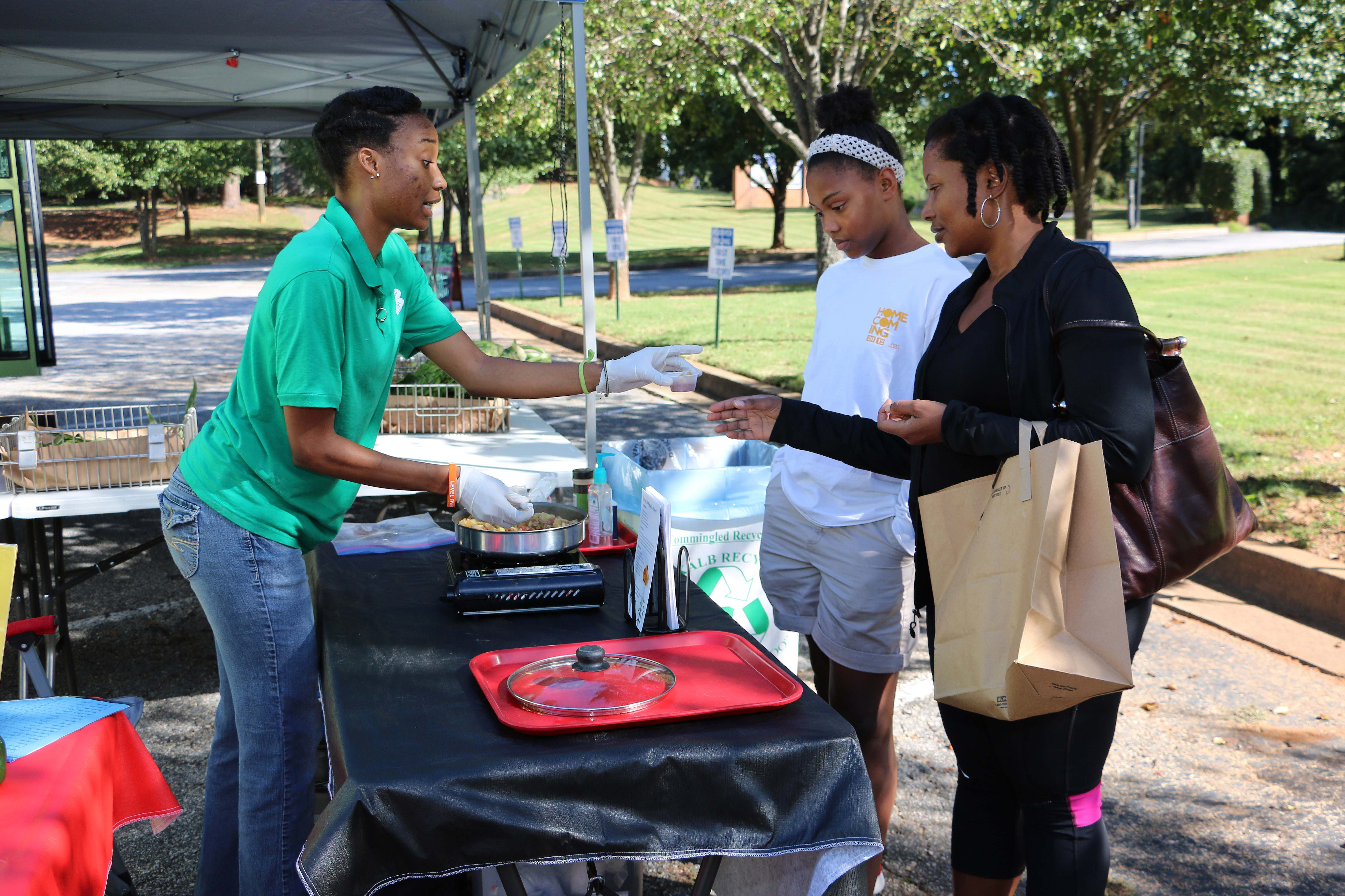 Christen Jackson, a USDA SNAP-Ed educator with UGA Extension in DeKalb County, prepares a healthy pasta dish as part of a nutrition demonstration at the DeKalb County Mobile Market.